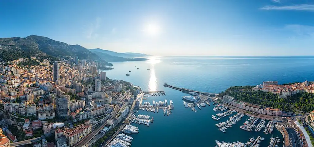 Panaromic image of Ariel view over French Riviera of Monaco. One can see beautiful port of Monaco with yachts parked around it.